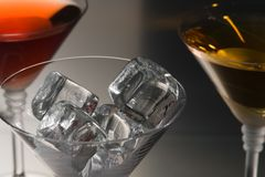 Ice for cocktail. Composition with drinks and ice stock images