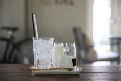 Iced coffee. On wooden table royalty free stock photos