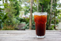 Ice coffee,americano,lemon tea,cola on wood table with green nature background. Copy space royalty free stock photo