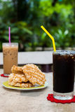 Ice coffee americano with Rice Cracker (Khao Tan) Royalty Free Stock Image