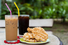 Ice coffee and americano with Rice Cracker (Khao Tan) Royalty Free Stock Photos