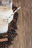 Ice coffee background. Ice coffee with spices in jug and glasses. Selective focus. Copy space background Stock Photos