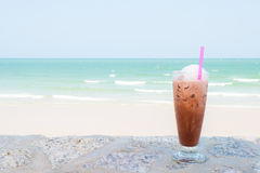 Ice coffee on the beach Stock Images