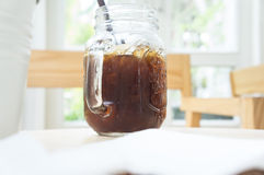 Ice coffee. Cold black coffee on the table in a coffee shop Stock Photos