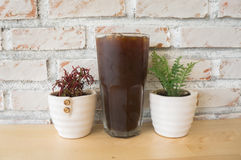 Ice coffee. Cold black coffee on the table in a coffee shop Royalty Free Stock Photography