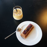 Ice coffee with delicious dessert on black table Royalty Free Stock Images