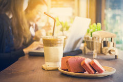 Ice coffee in disposable coffee cup and cake dessert during business time Royalty Free Stock Photo