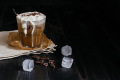 Ice coffee drink with chocolate and ice cubes on the wooden table, with copy space.  Royalty Free Stock Photography