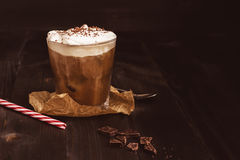 Ice coffee drink with chocolate on the wooden table, with copy space.  Royalty Free Stock Photo