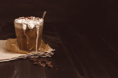 Ice coffee drink with chocolate on the wooden table, with copy space.  Stock Photos