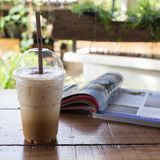 Ice coffee drink on wooden table, coffee break Stock Images