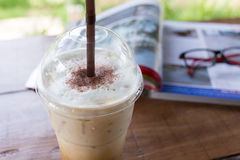 Ice coffee drink on wooden table, coffee break Royalty Free Stock Photos