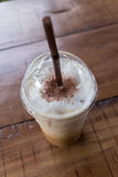 Ice coffee drink on wooden table, coffee break Royalty Free Stock Photo