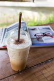 Ice coffee drink on wooden table, coffee break Royalty Free Stock Image