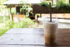 Ice coffee drink on wooden table, coffee break Stock Image
