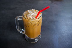 Ice Coffee. Glass of Cold Ice Coffee On grunge tray, image dark tone Stock Photography