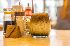 Ice coffee. Iced latte coffee on table number seven Royalty Free Stock Photos