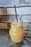 Ice coffee jug beside the wall Royalty Free Stock Photo