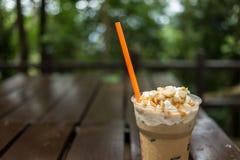 Ice coffee with macadamia nuts Royalty Free Stock Photos