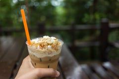 Ice coffee with macadamia nuts Stock Photos