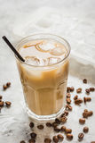 Ice coffee with milk and beans for lunch on stone background Stock Photo