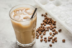 Ice coffee with milk and beans for lunch on stone background Stock Images