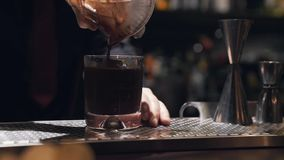 Ice coffee that is poured into the cup. At the bar. Footage in HD stock video footage