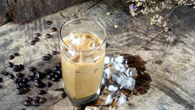 Ice Coffee. Put on a wood table with dark roasted coffee beans Stock Photography