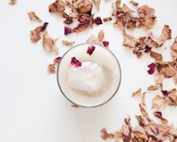 Ice coffee and rose petals Stock Photography