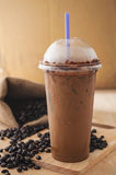 Ice coffee smoothie with fresh coffee on a wooden background Royalty Free Stock Photography