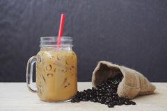 Ice coffee smoothie with roasted coffee, Still life tone. Ice coffee smoothie with roasted coffee on a wooden background, Still life tone royalty free stock photo