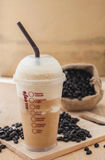 Ice coffee smoothie with roasted coffee on a wooden background Royalty Free Stock Image