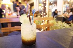 Iced coffee with soda. On wooden table stock photos