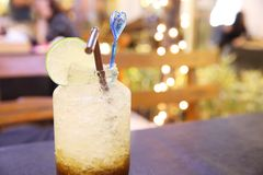 Iced coffee with soda. On wooden table royalty free stock photo