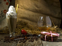 Ice coffee in still life picturesque photo on old wooden backgro Stock Photography