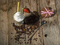 Ice coffee in still life picturesque photo on old wooden backgro Royalty Free Stock Image