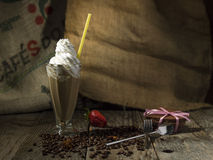 Ice coffee in still life picturesque photo on old wooden backgro Stock Image