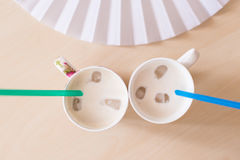 Ice coffee. With straws and fan on the table Stock Photography