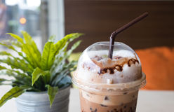 Ice coffee in take away plastic glass Stock Photos