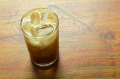Ice coffee topping milk floating with straw in glass. Ice coffee topping milk floating with straw in the glass Royalty Free Stock Photos