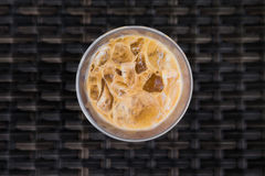 Ice coffee topview on wood background. Ice coffee topview on black basketwork background Royalty Free Stock Photography
