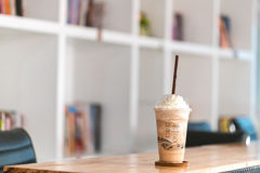 Ice coffee on wooden in cafe royalty free stock image