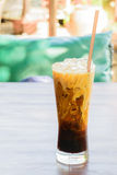Ice coffee on the wooden table Stock Photos