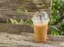 Ice coffee on a wooden table Stock Images