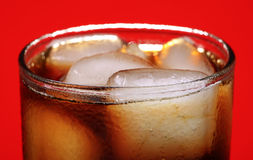 Ice and coke. Closeup shot of ice cubes in coke glass Royalty Free Stock Image