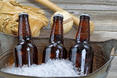 Ice Cold Bottle Beer and Baseball Stuff royalty free stock images