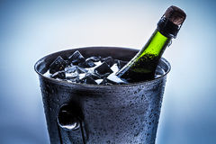 Ice cold bucket with cold champagne Stock Images