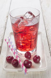 Ice cold cherry juice and freshly washed cherries Stock Photo