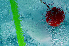 Ice Cold Drink. Fresh cherry, straw and ice in a carbonated beverage royalty free stock photos