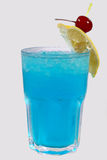 Ice cold drink with cherry and lemon Royalty Free Stock Image